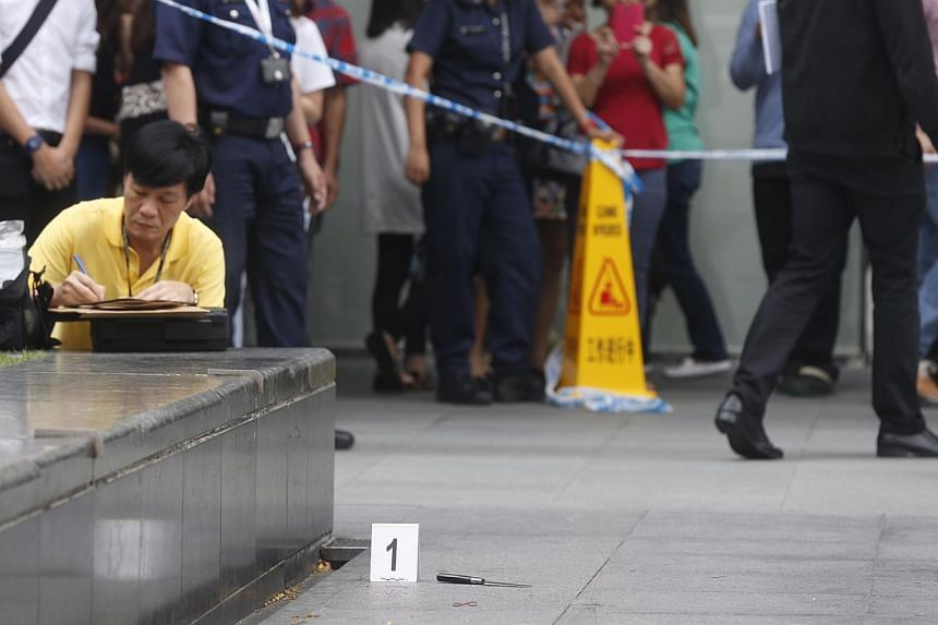 A fight between two men apparently broke out at Raffles Green during lunchtime on Friday, leaving one badly wounded.-- ST PHOTO: KEVIN LIM