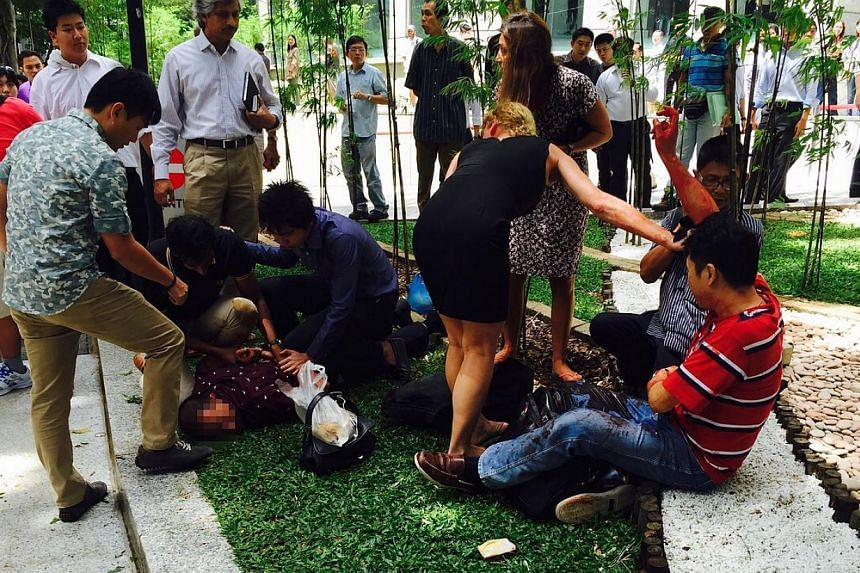 A fight between two men apparently broke out at Raffles Green during lunchtime on Friday, leaving one badly wounded.-- PHOTO: LEON LEE