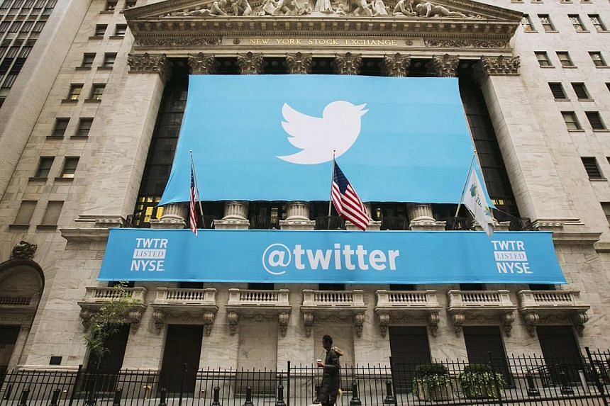 """A sign displays the Twitter logo on the front of the New York Stock Exchange ahead of the company's IPO in New York in this Nov 7, 2013 file photo.Standard & Poor's gave Twitter's recent US$1.8 billion (S$2.3 billion) debt issue a """"speculat"""