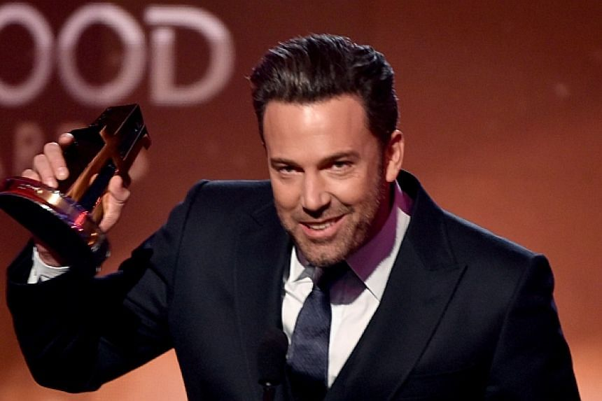 Actor Ben Affleck accepts the Hollywood Film Award for Gone Girl onstage during the 18th Annual Hollywood Film Awards at The Palladium on Nov 14, 2014 in Hollywood, California. -- PHOTO: AFP