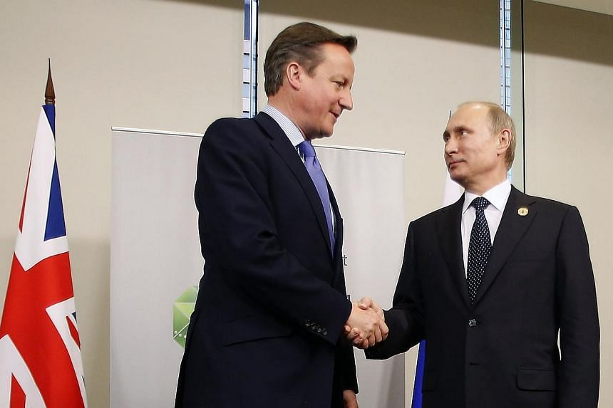 British Prime Minister David Cameron (left) shakes hands with Russian President Vladimir Putin during their bilateral meeting on the side of the G20 leaders summit in Brisbane on Nov 15, 2014. Russian President Vladimir Putin and British Prime M