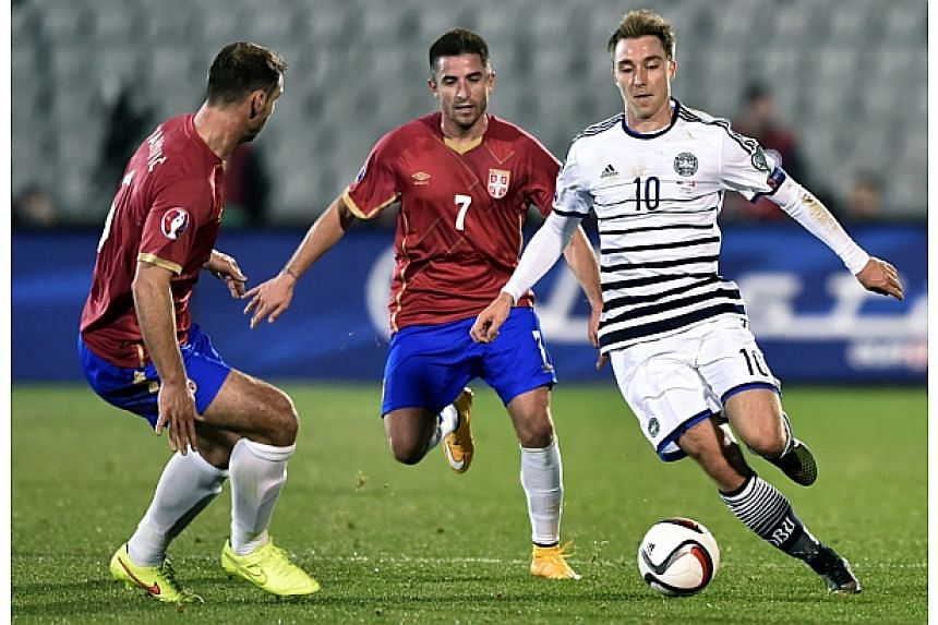 Denmark's midfielder Christian Eriksen (right) vies for the ball with Serbia's striker Zoran Tosic (centre) and Serbia's defender Branislav Ivanovic (left) during the Euro 2016 group I qualifying football match between Serbia and Denmark in Belgrade