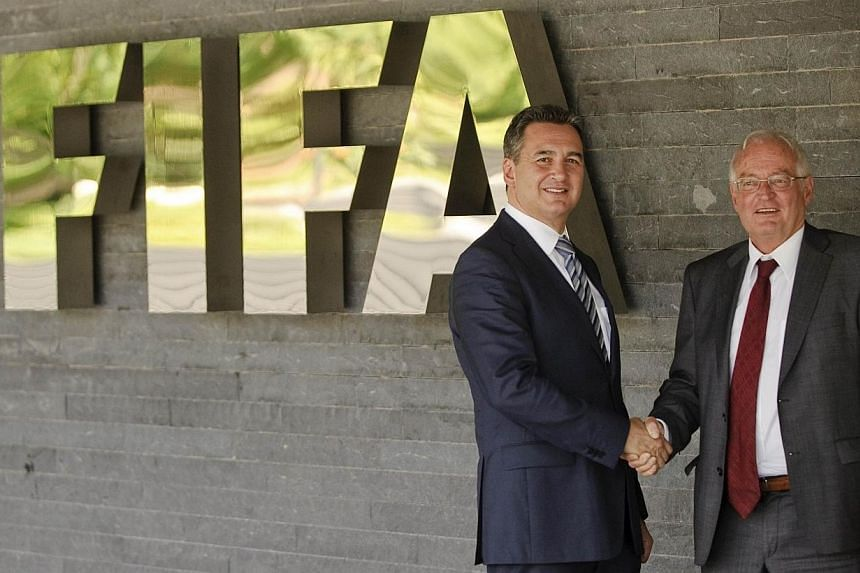Mr Michael J Garcia (left), Chairman of the investigatory chamber of the Fifa Ethics Committee, and Mr Hans-Joachim Eckert, Chairman of the adjudicatory chamber of the Fifa Ethics Committee posing for photographers after a press conference at Fifa he