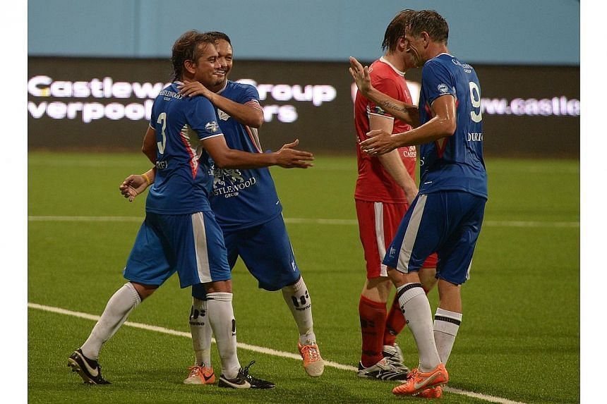 Rafi Ali (left) celebrates with Fandi Ahmad (centre) and Aleksandar Duric after scoring against the former Reds. -- ST PHOTO: DESMOND WEE