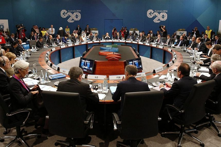 "Leaders meet at the first plenary session at the G20 summit in Brisbane on Nov 15, 2014.  Leaders of the world's most powerful economies on Saturday vowed to do all they can to ""extinguish"" the deadly Ebola outbreak in west Africa. -- PHOTO"