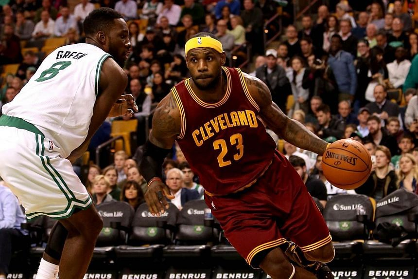 LeBron James of the Cleveland Cavaliers drives with the ball against Jeff Green of the Boston Celtics in the second half at TD Garden on Nov 14, 2014, in Boston, Massachusetts.-- PHOTO: AFP