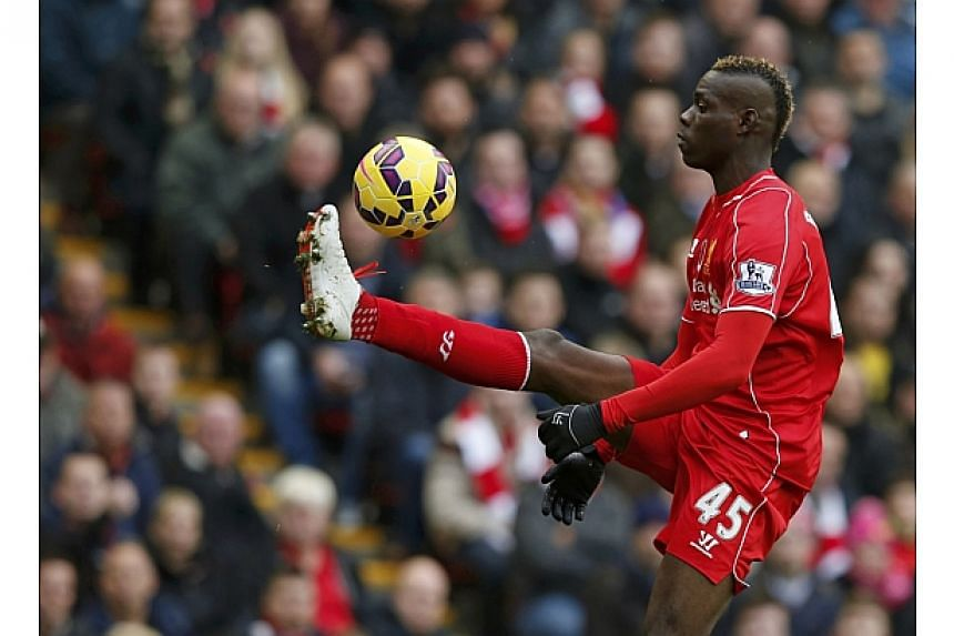 Liverpool's Mario Balotelli controls the ball during their English Premier League soccer match against Chelsea at Anfield in Liverpool, northern England on Nov 8, 2014. -- PHOTO: REUTERS