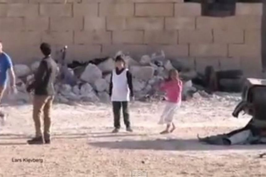 A viral video showing a Syrian boy rescuing a girl under gunfire, watched online by millions of viewers, was faked by a Norwegian film crew, the BBC reported. -- PHOTO: SCREENGRAB FROM YOUTUBE