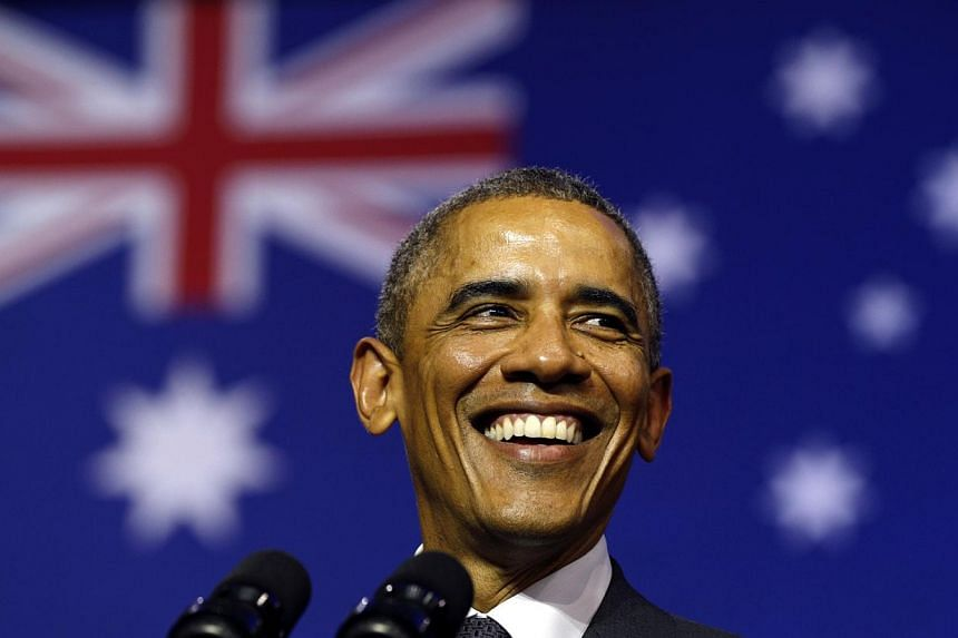 US President Barack Obama smiles broadly as he takes the stage to speak at the University of Queensland in Brisbane on Nov 15, 2014. -- PHOTO: REUTERS