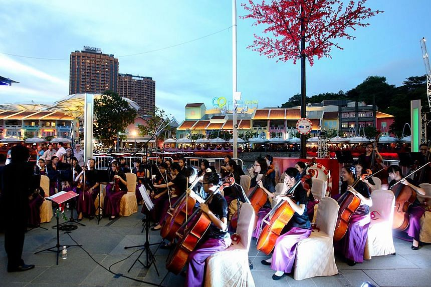 The Methodist Girls' School String Ensemble performed at the launch. -- PHOTO: SINGAPORE RIVER ONE