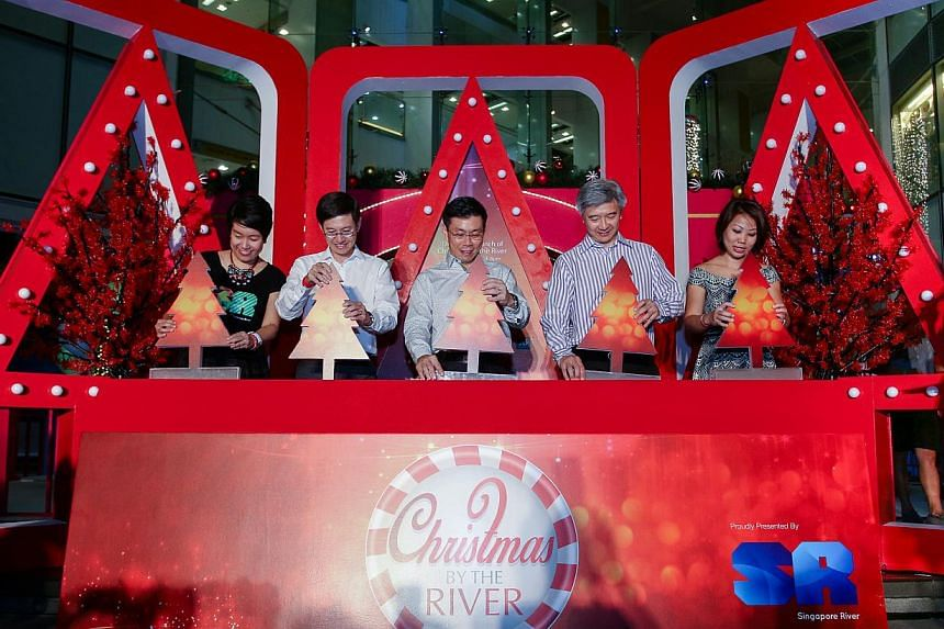 Senior Minister of State for Trade and Industry and National Development Lee Yi Shyan (centre) and Singapore River One chairman Wilson Tan (fourth from left) at the launch. -- PHOTO: SINGAPORE RIVER ONE