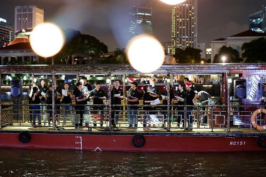 A floating choir performance by Vox Camerata. -- PHOTO: SINGAPORE RIVER ONE