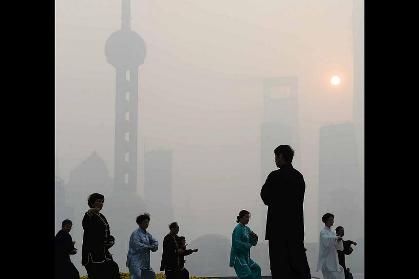 Residents exercising outdoors despite heavy smog in Shanghai on Wednesday. A recent report found that the health and mortality burden of air pollution in China accounts for more than 10 per cent of GDP.