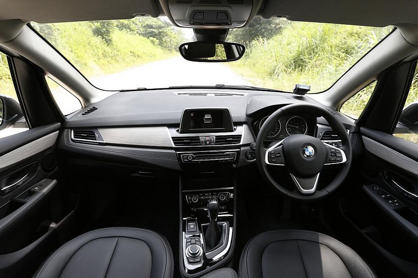 The cockpit of the BMW 218i Active Tourer is ergonomically designed and the car's height gives the driver a commanding view. -- ST PHOTO: DESMOND LIM
