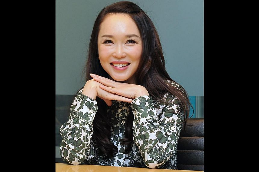 Actress Fann Wong is back on the film set with her first TV drama since giving birth three months ago. -- PHOTO: DIOS VINCOY JR FOR THE STRAITS TIMES