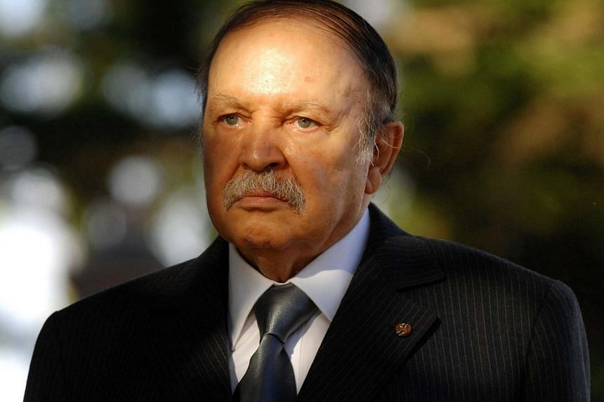 A file picture taken on Dec 11, 2011 shows Algerian President Abdelaziz Bouteflika waiting to greet the Mauritanian president upon his arrival in Algiers. Bouteflika, 77, has been hospitalised in a clinic in Grenoble, French Alps, a source said on No