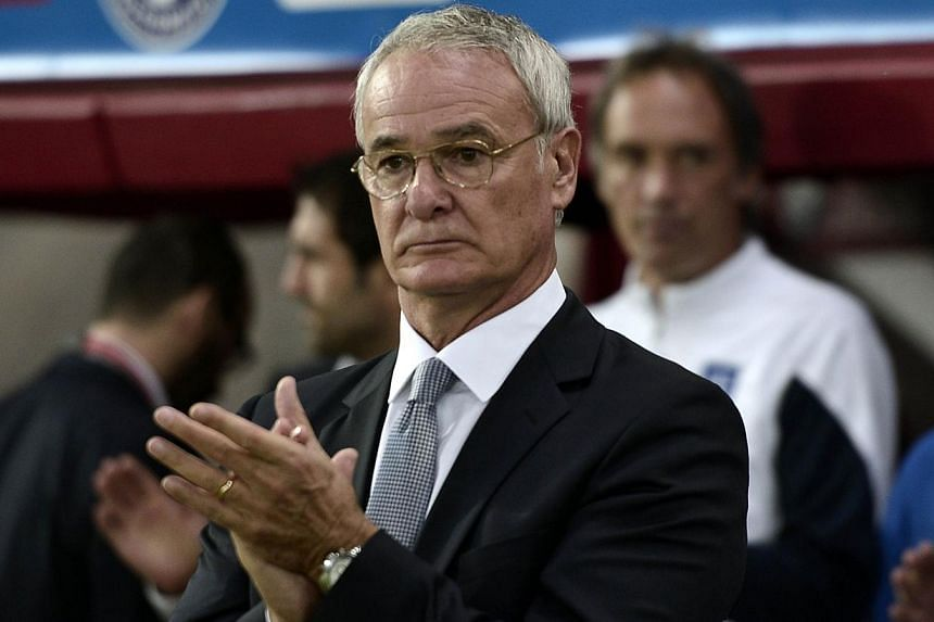 Greece's Italian coach Claudio Ranieri applauding during the Uefa Euro 2016 group F qualifying gootball match between Greece and Northern Ireland at the Karaiskaki stadium in Piraeus, near Athens on Oct 14, 2014. -- PHOTO: AFP