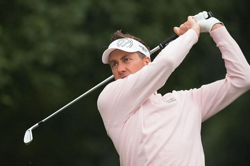 Ian Poulter of England tees off at the 5th hole during the 3rd day of the WGC-HSBC Champions Golf tournament in Shanghai on Nov 8, 2014. -- PHOTO: AFP