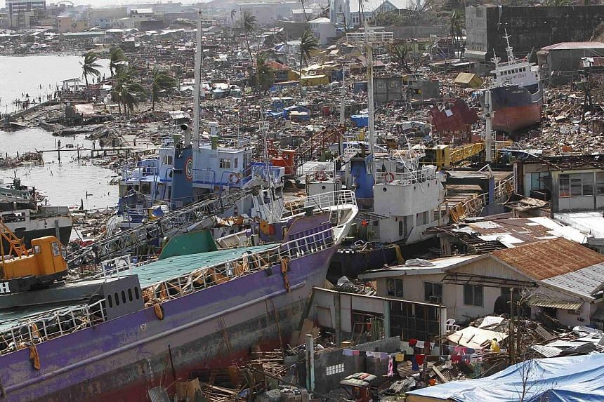 A view shows cargo ships washed ashore onto residential areas by super Typhoon Haiyan, in Tacloban city, central Philippines, in this Nov 11, 2013 file picture. Pope Francis will visit the Philippines region devastated by Typhoon Haiyan last yea