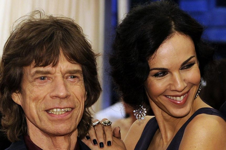 Musician Mick Jagger (left) and L'Wren Scott attend the Costume Institute Benefit at The Metropolitan Museum of Art in New York on May 7, 2012. -- PHOTO: AFP