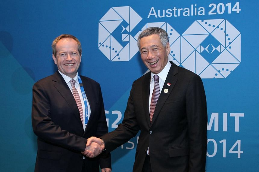 Singapore Prime Minister Lee Hsien Loong meeting Australia's opposition leader Bill Shortenon Nov 15, 2014 while in Brisbane for the Group of 20 Summit. --PHOTO: MINISTRY OF COMMUNICATIONS AND INFORMATION