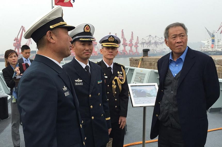 Defence Minister Ng Eng Hen (right) toured the PLA Navy's newest missile corvette Fushun at the Qingdao naval base, which is the headquarters for the PLA Navy's North Sea Fleet. -- PHOTO: ST FILE