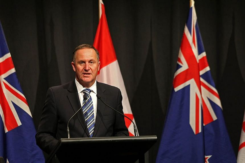New Zealand's Prime Minister John Key speaks at a joint press conference with Canada's prime minister in Auckland on Nov 14, 2014. -- PHOTO: AFP