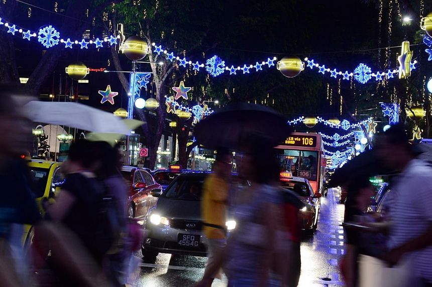 Lights illuminated Orchard Road minutes before 8pm on Sunday, marking the start of this year's Christmas light-up. -- ST PHOTO: AZIZ HUSSIN