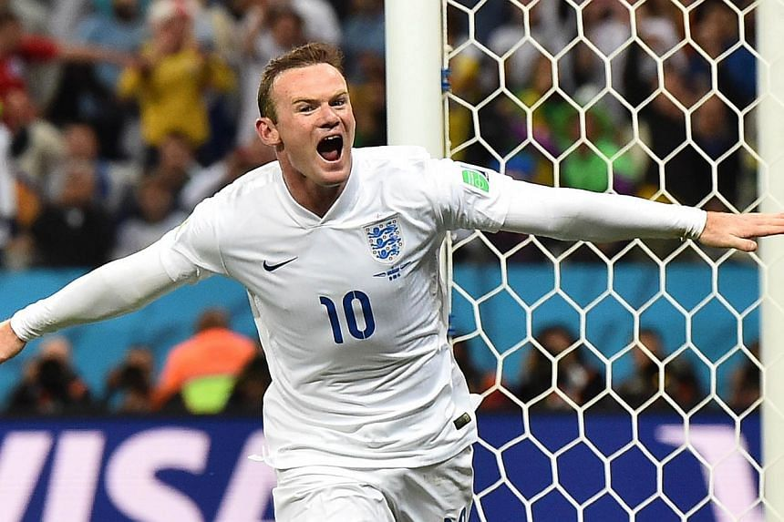 A file picture taken on June 19, 2014 shows England forward Wayne Rooney celebrating a goal during the 2014 Fifa World Cup. Rooney deserves to be thought of as an England great, national team manager Roy Hodgson said on Friday. -- PHOTO: AF