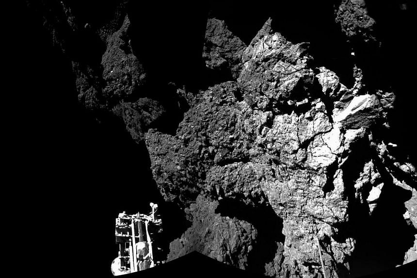 A view of the comet's surface from Philae, with one of the probe's three feet visible in the foreground. -- PHOTO: EUROPEAN SPACE AGENCY