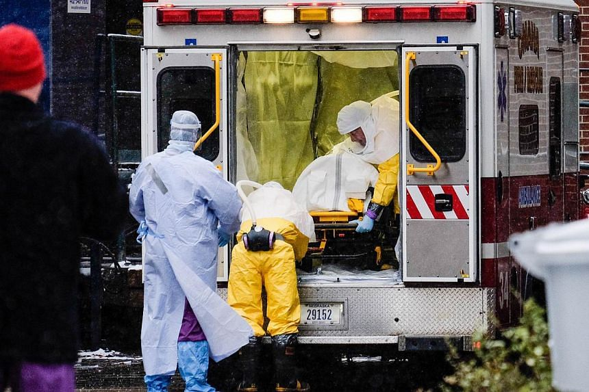 Dr. Martin Salia, a surgeon infected with the Ebola virus while working in Sierra Leone, arrives at the Nebraska Medical Center on Nov 15, 2014 in Omaha, Nebraska. -- PHOTO: AFP