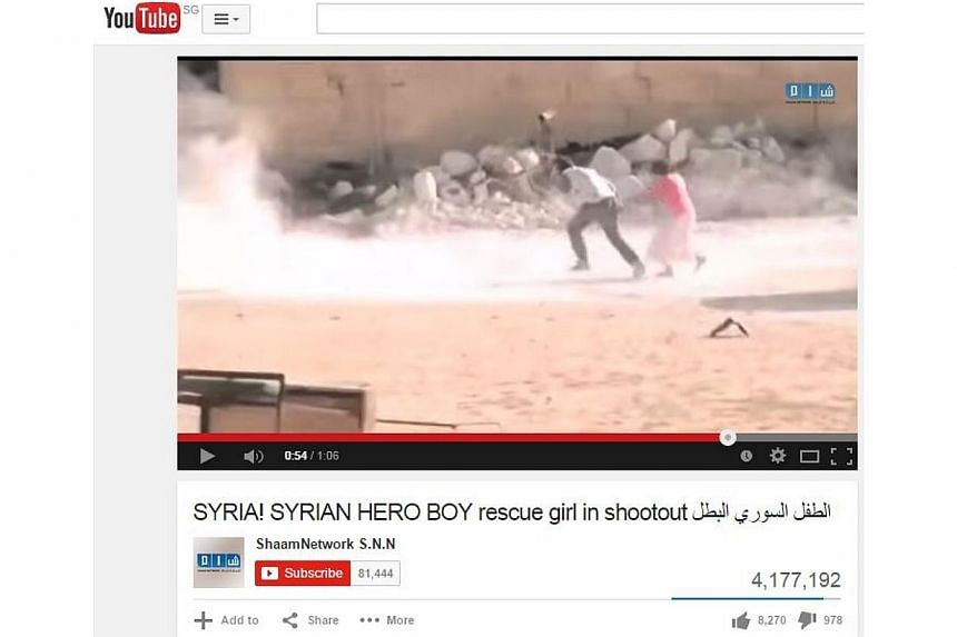 The producer of a viral video showing a Syrian boy rescuing a girl under gunfire apologised Sunday after the revelation it was fake drew fierce criticism. -- PHOTO: SCREENGRAB FROM YOUTUBE