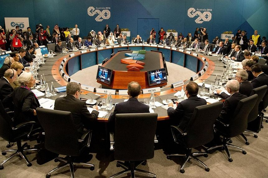 Leaders meet during a plenary session at the G20 leaders summit in Brisbane on Nov 15, 2014. Group of 20 (G-20) nations, which collectively comprise 85 per cent of the world economy, wrapped up their annual summit on Sunday (Nov 16, 2014) with agreem
