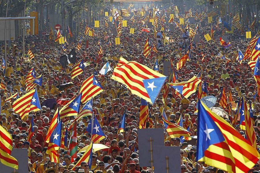 Catalans holding independentist flags (Estelada) and gathering on Gran Via de les Corts Catalanes during celebrations of Catalonia National Day (Diada) in Barcelona in September. In one of the few incidents reported, police arrested five people for d