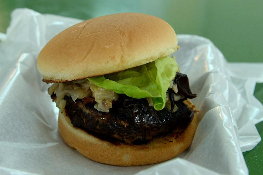 Buah Keluak Burger. -- ST PHOTO: AZIZ HUSSIN