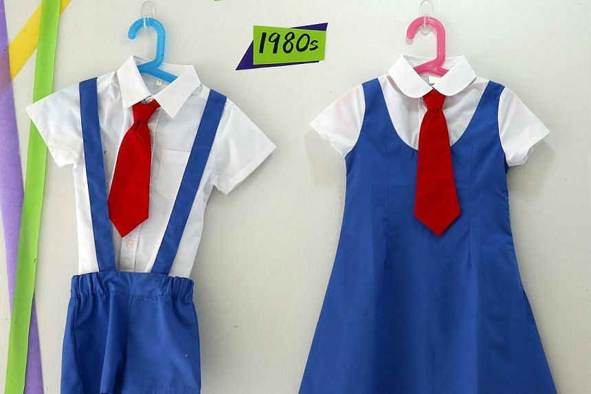 The uniforms for children attending PAP Community Foundation kindergartens have evolved over the years, from the blue and white attire of the 1980s (far right), to the latest iteration (main picture).