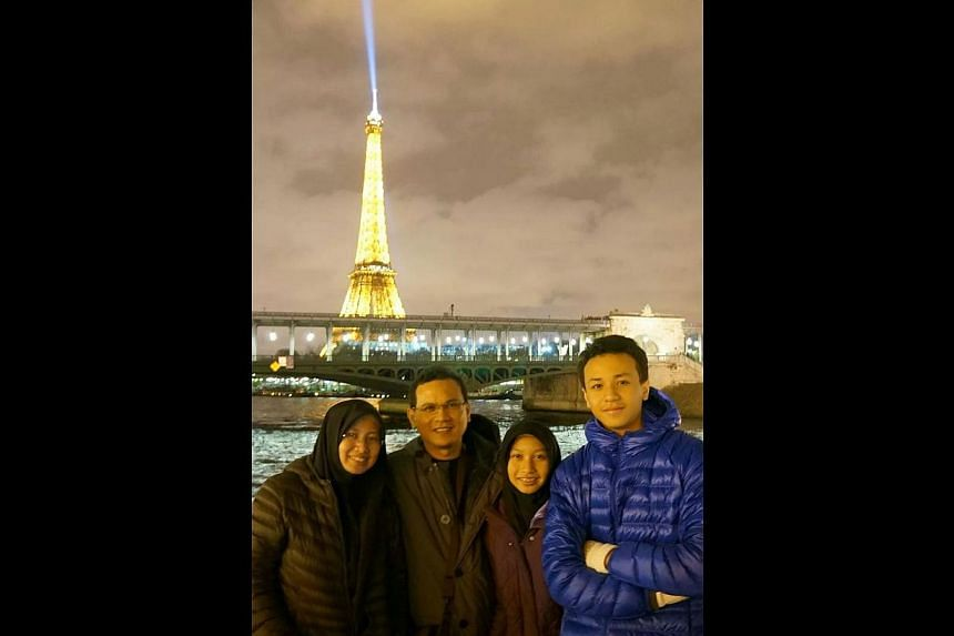 Mr Yusof Kassim and his family (above) have travelled to Paris in France while Ms Anita Sahari and her husband have visited South Korea. -- PHOTO: COURTESY OF YUSOF KASSIM