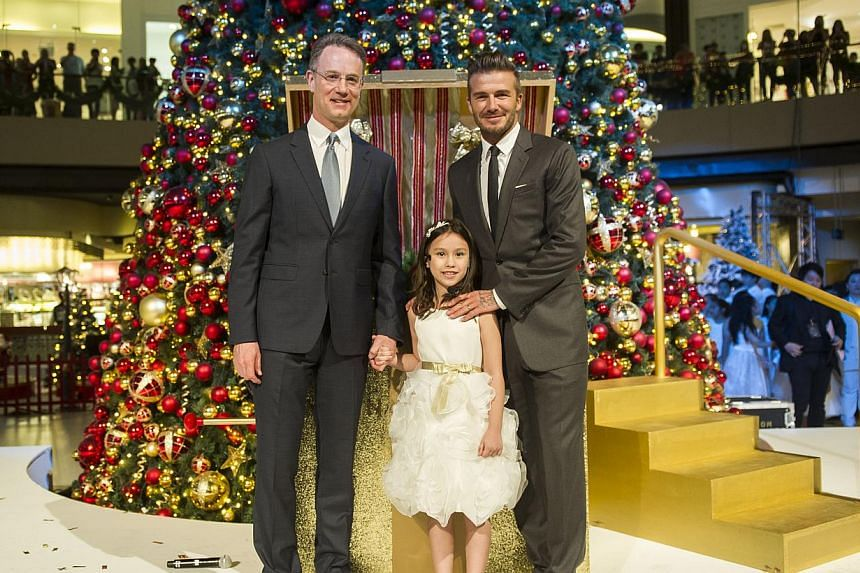 Mr. George Tanasijevich, President and Chief Executive Officer of Marina Bay Sands and David Beckham with Kayla at Marina Bay Sands Festive Light-up. -- PHOTO: MARINA BAY SANDS