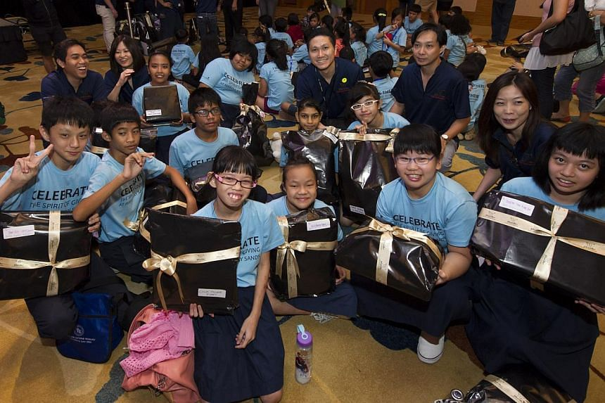 Sands for Singapore beneficiaries with their presents from Marina Bay Sands Team Members. -- PHOTO: MARINA BAY SANDS
