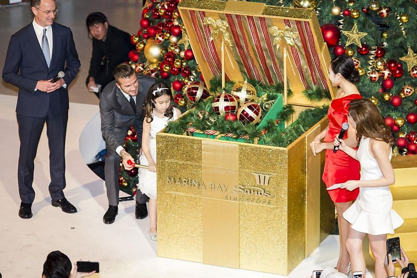 David Beckham and Kayla opening the Jack in a Box for the Festive Light-up. -- PHOTO: MARINA BAY SANDS
