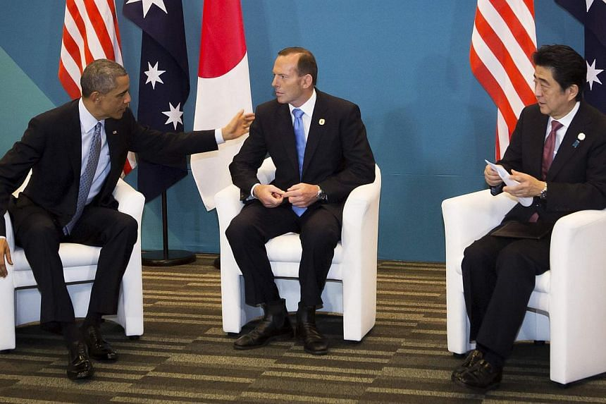 US President Barack Obama (left) meets with Australia's Prime Minister Tony Abbott, and Japan's Prime Minister Shinzo Abe during a trilateral meeting at the G20 conference in Brisbane, on Nov 16, 2014. -- PHOTO: REUTERS