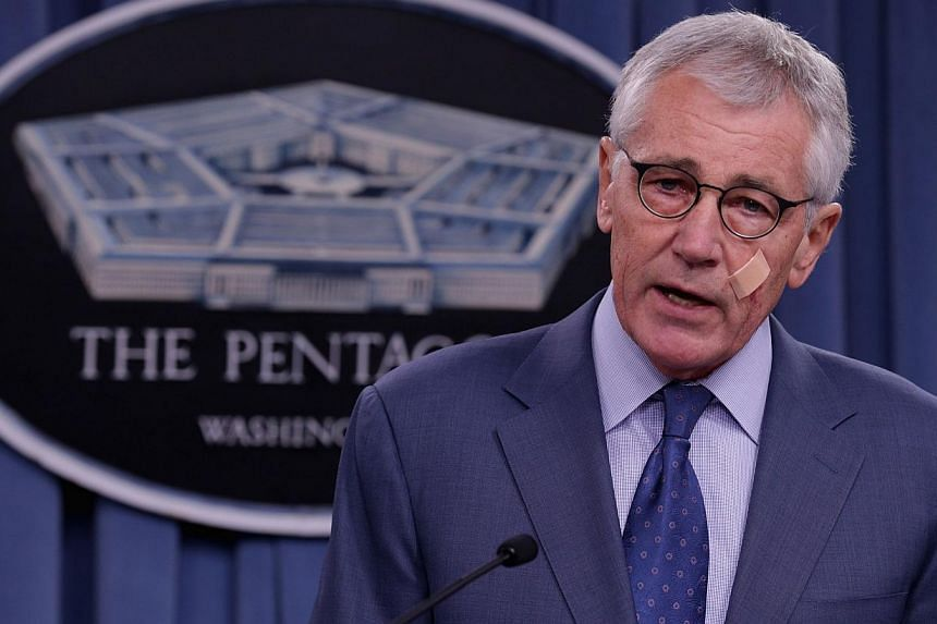 US Defense Secretary Chuck Hagel announces a series of reforms to the troubled nuclear force during a press briefing at the Pentagon in Arlington, Virginia on Nov 14, 2014. -- PHOTO: AFP
