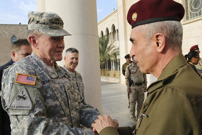 Iraq's army chief, Lieutenant-General Babakir Zebari (right) meets US Army General Martin Dempsey, chairman of the Joint Chiefs of Staff, at the defence ministry in Baghdad Nov 15, 2014. Dempsey arrived on Saturday in Baghdad on an unannounced visit