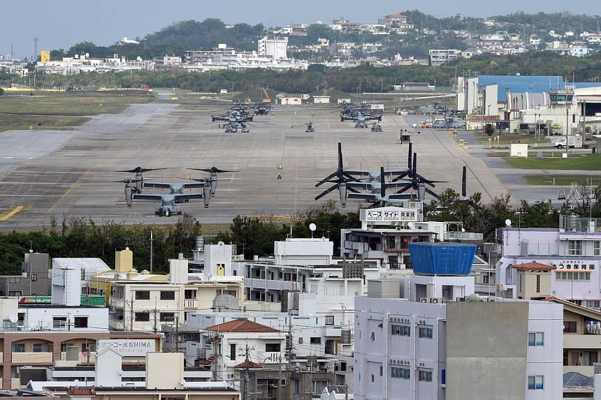 Osprey aircrafts at the US Marine's Camp Futenma in a crowded urban area of Ginowan, Okinawa prefecture. -- PHOTO: AFP