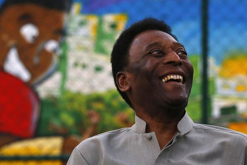 Brazilian soccer legend Pele laughs during the inauguration of a refurbished soccer field at the Mineira slum in Rio de Janeiro Sept 10, 2014.Pele was released from hospital on Saturday after undergoing surgery for kidney stones, hospital offic