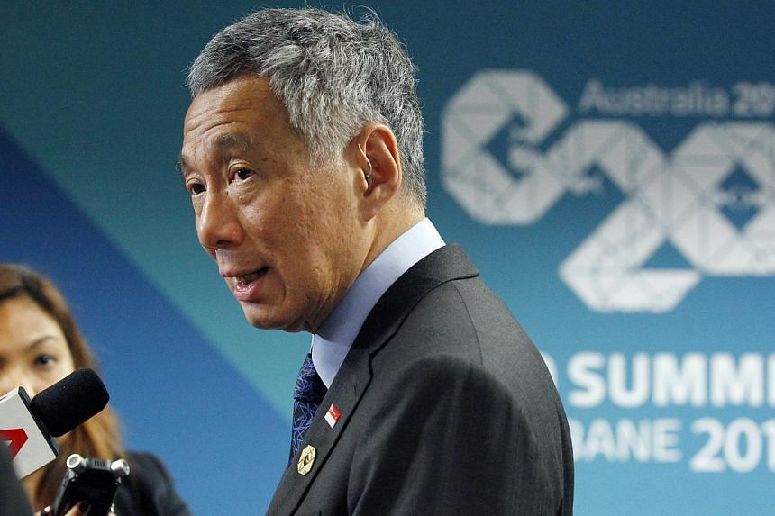 Prime Minister Lee Hsien Loong speaks to members of the Singapore media during a wrap-on session at the G-20 leaders Summit in Brisbane on Sunday, Nov 16, 2014.PM Lee said that the grouping must not lose focus of its core mandate of getting glo