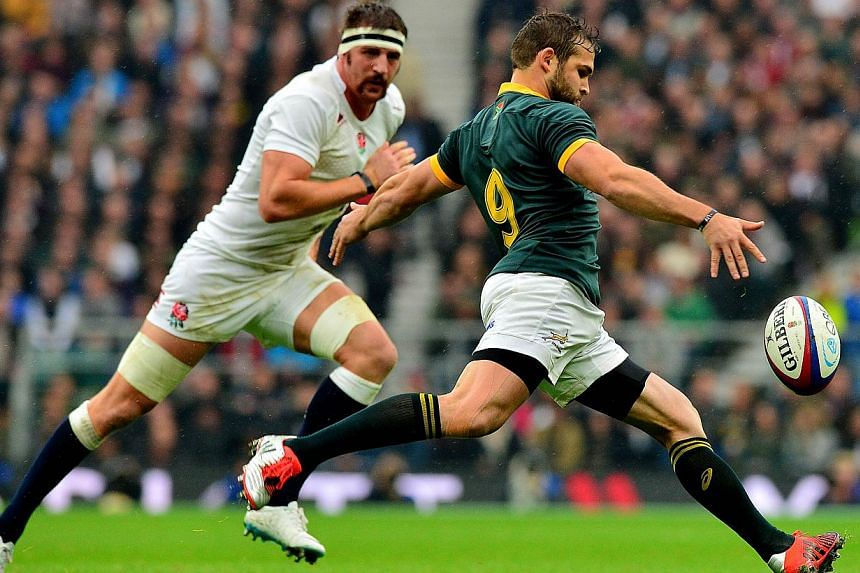 South Africa's scrum half Cobus Reinach (right) clears the ball from a scrum during the Autumn International rugby union Test match between England and South Africa at Twickenham Stadium, south-west of London on Nov 15, 2014. South Africa returned to