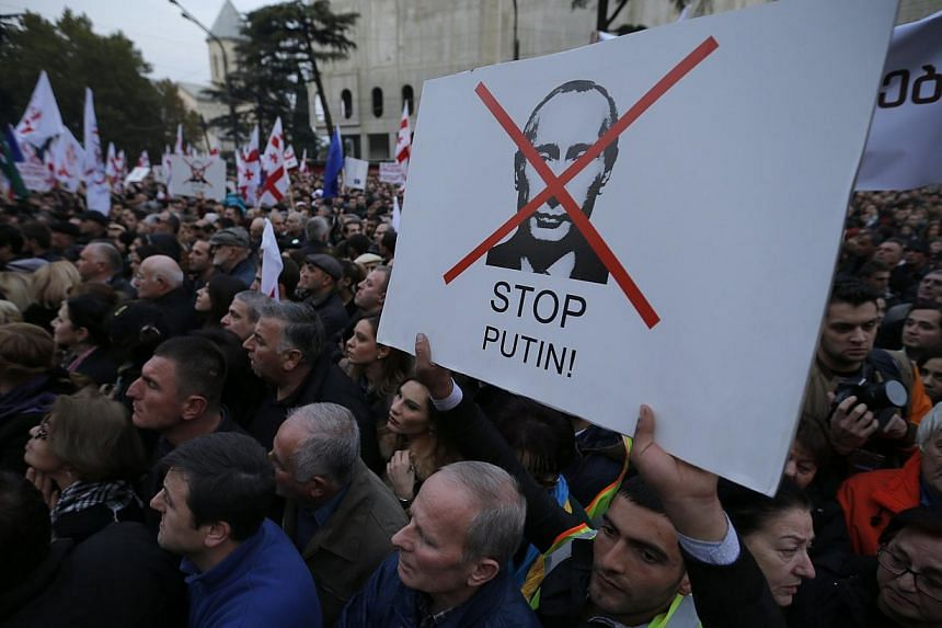 People attend an opposition rally to protest against Russia's policy towards Georgia and Ukraine in Tbilisi, Nov 15, 2014. -- PHOTO: REUTERS