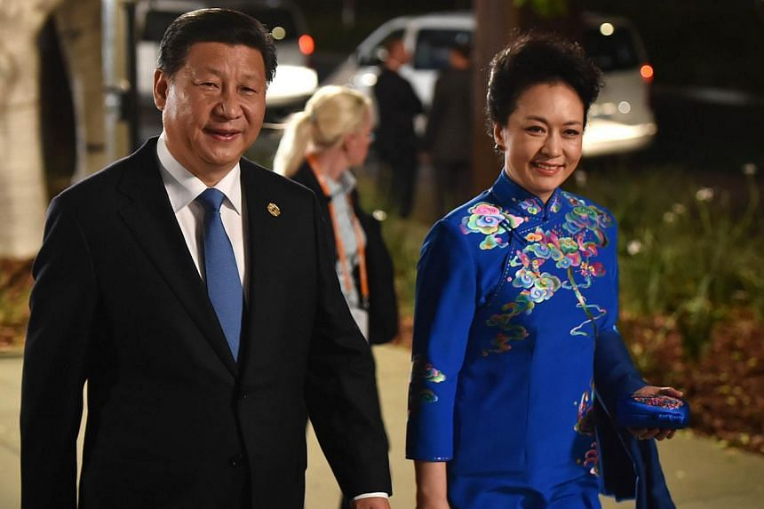 China's President Xi Jinping and his wife Peng Liyuan arrive at the Gallery of Modern Art in Brisbane as he takes part in the G-20 Summit on Nov 15, 2014. President Xi said on Saturday China's economy will maintain strong, sustainable and balanced gr