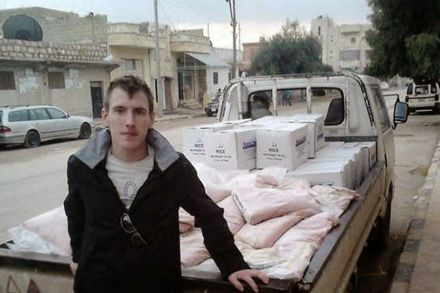 """President Barack Obama confirmed on Sunday the death of US aid worker Peter Kassig, calling his beheading at the hands of the Islamic State group """"pure evil."""" -- PHOTO: AFP"""